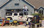 Founder, John Hamrick sits atop the Hummer and displays just some of the equipment he uses during emergencies.
